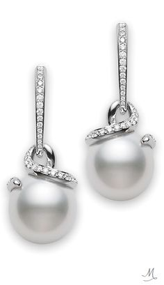 http://rubies.work/0805-multi-gemstone-earrings/ South Sea Pearl & Diamond Earrings by Mikimoto.