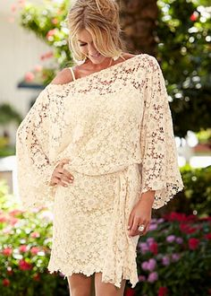 Very romantic belted lace dress. This would be nice for the rehearsal dinner, maybe? It could also work for a second wedding/marriage.