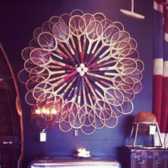 game room tennis racquet display. Upcycle  vintage wooden tennis racquets.