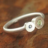 Peridot/Sapphire/silver ring. My kids' birthstones and just my style.  :-)  Novica $37.95