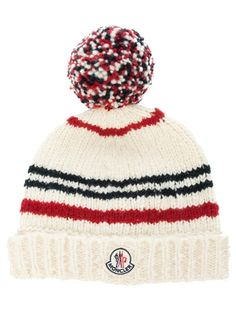 Nude wool knitted beanie hat from Moncler featuring an all over ribbed design, a contrasting red and blue bobble to the top and a white patch logo to the front.