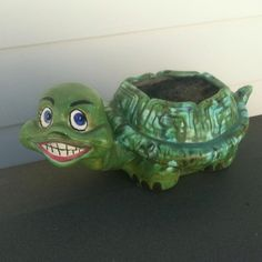 Creepy smiling turtle planter