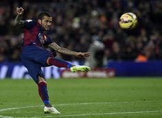Barcelona's Brazilian defender Dani Alves kicks a ball during the Spanish league football match FC Barcelona vs Villarreal CF at the Camp Nou stadium in Barcelona on February 1, 2015