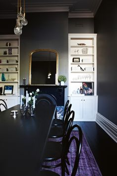 Dark paint adds drama to a traditional Victorian home.