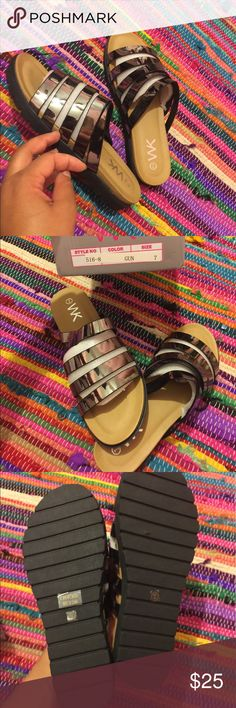 Metallic gun metal silver summer sandals Metallic gun metal silver summer sandals Brand new , never worn SIZE: 7 Women's Sandals  New in the box  Perfect for the upcoming summer Will match nearly everything Shoes Sandals