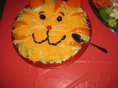 #danieltiger, Daniel Tiger, Taco dip, Kid's birthday party, Daniel Tiger Party Food or snack, PBS, Mr.Rogers  Decorate top layer of taco dip with yellow peppers for tiger stripes, black olives for eyes and mouth, and string cheese pieces as whiskers :)