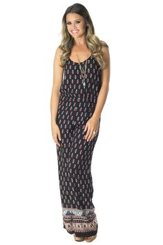 This paisley jumpsuit reminds us of something Jackie would wear on the TV series, That 70's Show. You will want to find your favorite pair of wedges to have that long leg look. Model is wearing a small.