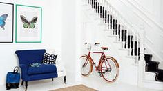 Bring your hallway out of the darkness by using the power of bright, crisp colours.