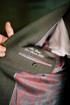 Name and wedding date embroidered inside groom's suit.... definitely want to do something similar since we're making his vest, Mom!!