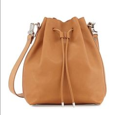 """Proenza Schouler Buffalo Large Bucket Bag w/ Pouch Proenza Schouler Buffalo Leather Large Bucket Bag w/ Pouch in Desert Copper.  Sad guano calfskin strap; 20"""" drop.  Drawstring cinched top.  Crackled metallic leather lining and pouch.  Approx. 12.3""""H X 6""""W X 9""""D.  Made in Italy.  Comes with tags and dust bag.  In pristine condition NWT Proenza Schouler Bags Shoulder Bags"""