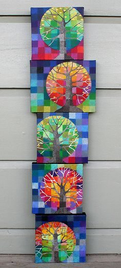 The squares are coloured in oil pastel, which is scratched into with an embossing tool. Then a layer of watercolour, then the trunk and branches are painted in acrylics.
