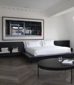 .bed with attached bedside table;; chevron floor; sleek, modern (minus the large moldings)