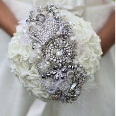 A cross between a traditional bridal bouquet and the trendy brooch bouquet!