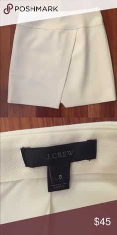 "white/ cream j. crew cross skirt, size 8 stylish skirt in white/ slight off white from j. Crew. front features a cross panel. fully lined with zipper in back. in perfect condition, no stains. please ask all questions before purchasing. all serious offers made via the ""offer"" button will be considered. J. Crew Skirts Mini"
