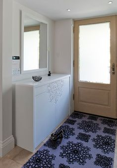 Contemporary Residence by Jill Greaves at Houzz /  Jill Greaves Design Contemporary Entry with Custom Corian Shoe Cabinet and Mirror. Custom Carpet Runner with Raised Pattern. Photo by Philip Castleton