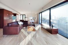 Chic Home Design Model in the City: Spacious South Perth House Living Room Interior Furnished With Brown Leather Upholstered Sofa Set