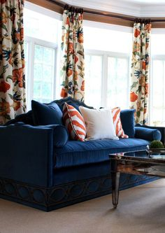 Pretty bay window in living room dressed with bold orange and royal blue floral ...  Porter Design Company