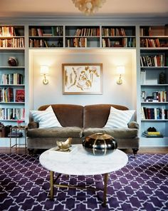 like the bookcase and the velvet couch - not sure about the rug and pillows or the table...