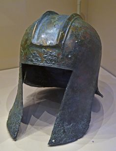 Ancient Greek helmets from the Archaic period BC – 480 BCE). The first shown is of the Corinthian-type, and was found in Leivadia. The second is a Illyrian-type helmet from Leivadia. Greek Helmet, Helmet Head, Ancient Romans, Ancient Art, Modern Names, Corinthian, My Collection, Ancient Greece, Archaeology