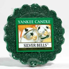 Silver Bells Yankee Candle Company Tarts® Wax Melts - Ring in Christmas with fresh notes of cypress, spruce, apple, wild berry, clove and white cedar.