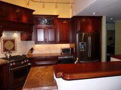 Custom Cabinets, Stained Cherry Wood, Granite Countertops, Kitchen Remodel, Farmhouse Sink. www.keystonekitchens.biz