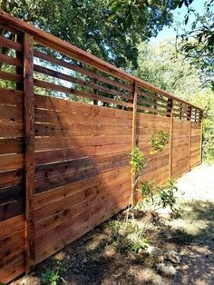 77 DIY Backyard Privacy Fence Design Ideas On A Budget 11 - onlyhomely Lattice Privacy Fence, Privacy Fence Designs, Backyard Privacy, Privacy Fences, Bamboo Fence, Cedar Fence, Backyard Fences, Fence Panels, Garden Fencing