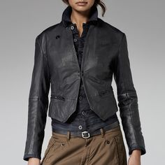 Tailored leather overshirt with long lapels and a clasp close. Denim facing lines the cuffs. A long narrow cinch trims the back.