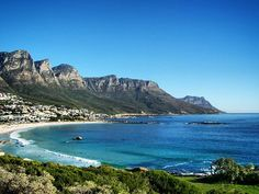 Camps Bay just 10 minute drive from central Cape Town draws crowds to its beach known for its fine white sand natural rock swimming pool and views of Twelve Apostles mountains. Camps, Cape Town, South Africa, Swimming Pools, Anna, Mountains, Rock, Natural, Drawings