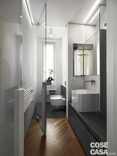 110 mq con una parete in vetro per dividere soggiorno e corridoio e con la cabina armadio dietro al letto - Cose di Casa