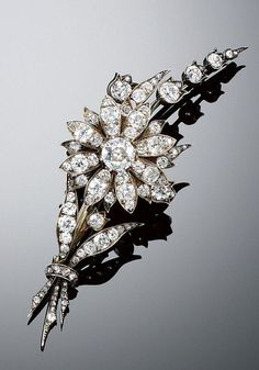 DIAMOND BROOCH, 1880S. Designed as a floral spray, composed of a central flower en tremblant, the leaves and buds set with circular- and rose-cut diamonds, accompanied by two pronged hair fittings, a small brooch fitting and an additional diamond leaf, fitted case by Hunt and Roskell, London.