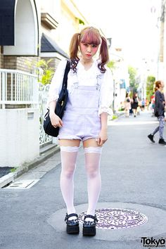 """Tetsuko Okuhira (aka """"Peco"""") is an 18-year-old student and model who we recently ran into in Harajuku. Her super kawaii look features twin tails and bangs, with purple ombre hair."""