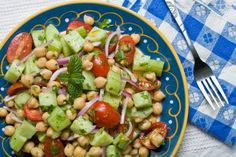 This Chickpea Cucumber Salad is so tasty. Love it through the spring and summer months! #chickpeasalad #cucumbersalad #saladideas