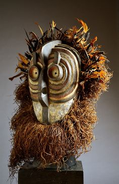 Central Africa   Bird mask from the Luba or Songye people of DR Congo   Wood, raffia, fibre, beads, shells    Mid 20th century