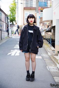 18-year-old Mo-Chi on the street in Harajuku wearing all black resale fashion with fishnets and Nadia Harajuku platform creepers.
