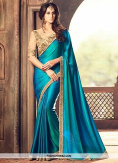 """Checkout on Roposo.com - SATIN SILK DESIGNER TRADITIONAL SAREE FOR CEREMONIALGrab the second look in this elegant attire for this season. We unfurl our the intricacy and exclusivity of our creations highlighted in this lovely blue satin silk designer <a href=""""https://www.fashionwebz.com/saree"""">traditional Indian saree</a>. Beautified and stylized with embroidered, lace, resham and stone work to give you an attractive look. Comes with matching blouse."""