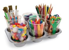 "organize student supplies for art in clear cups with magnets ""buttons"" attached to the bottom and set into muffin tin.  This would be awesome using an old muffin tin that you spray paint a FUN color!!!"