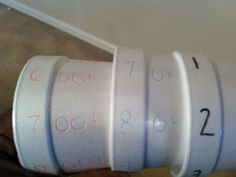 use stacked styrofoam cups to show how expanded form is linked to standard form