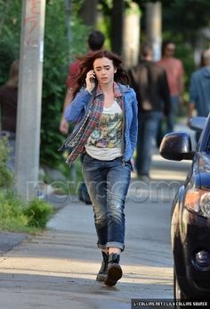 i'm guessing this scene is the scene where clary's mom calls her and tells her to stay at simons and to not come home cause it's not safe and she's running to her home to make sure she's okay. lily collins looks so good!