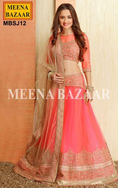 Neon Pink Net Lehenga Choli - Emulate the latest trend and style in this set featuring mesmerizing Baroque embroidery in shaded neon pink Lehenga Choli. Its teamed up with similar color Choli with Swarovski Crystal and Heavy Baroque Embroidery and a contrast Beige Dupatta. The Dupatta Spells out glamour further with tassles and gold beads along with similar baroque embroidery as the lehenga.