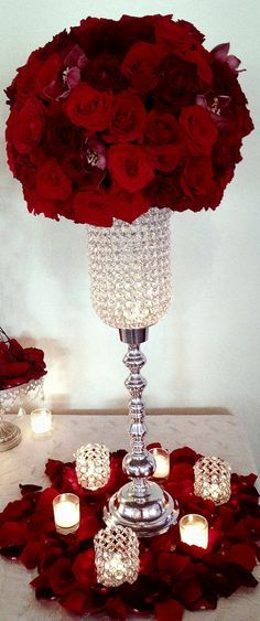 Red centerpiece, using roses orchids and dahlias. Our signature crystal candelabras our just stunning. Our signature pieces show best with flowers or candles. This piece is just very glam!