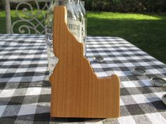 Handmade wooden Bottle Opener in shape of The Great State of Idaho. The body wood is Alder. The screws are made out of metal. Size approx. 5 1/2 inch long x 3 3/8 inch wide x 3/4 inch thick. Featuring Rare Earth Magnets to retain the bottle cap and extra one to hold onto your refrigerator.