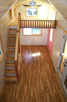 More my kind of loft - stairs and railing and lots of light. This whole tiny house seems pretty livable. molecule tiny house 13 398x600   Molecule Builds Another Spacious Tiny Home on a Trailer
