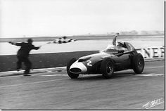 1958- Stirling Moss (Vanwall VW5) wins the Grand Prix of Portugal