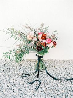 Chic bridal bouquet with ribbon | Ana Lui Photography | see more on: http://burnettsboards.com/2015/05/edgy-flamenco-wedding-inspiration/