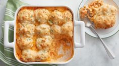 Cheesy onion biscuits top a creamy filling that brings all the flavors of Buffalo wings to a crowd-pleasing weeknight casserole.