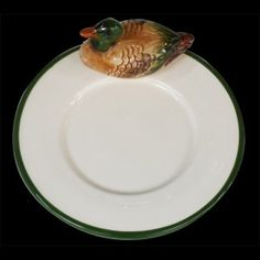 Duck on side of a small plate D16,6cm