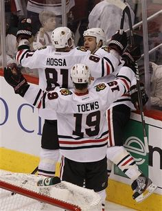 Brent Seabrook, Marian Hossa, and Jonathan Toews celebrate Seabrook's game-tying goal in the 3rd period on 4/12/2012 - Game 1 vs. Phoenix