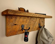 This rustic coat rack and shelf will add warmth to your mudroom, foyer or use it in your bathroom for robes.