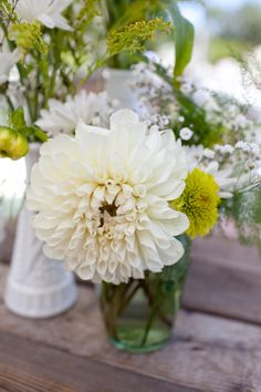 Darling dinner plate dahlia. Love the grouping of small vases.