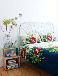 Airy bedroom ~ Floral bedding, iron bed
